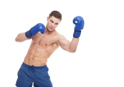 Muscular guy in boxing glove punches an uppercut on a white isolated background