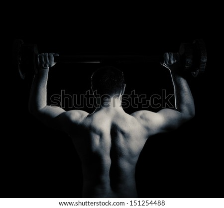 muscular guy with a barbell