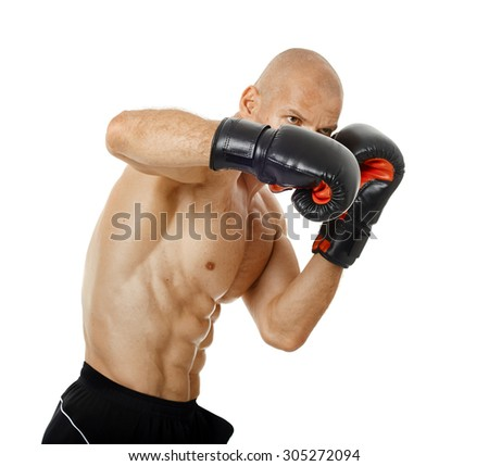 Muscular kickbox or muay thai fighter punching, isolated on white background