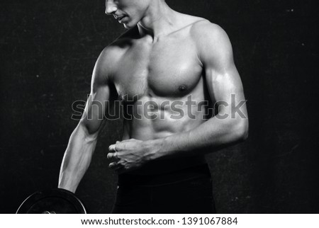 muscular male athlete with muscular naked torso workout fitness dark background