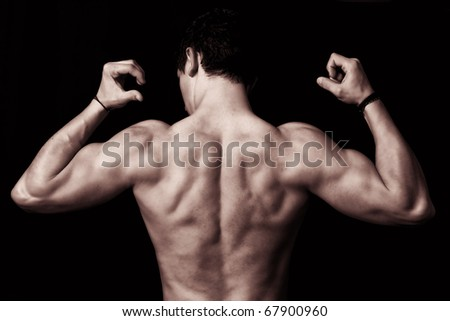 muscular male back on black background