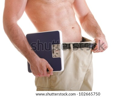 Muscular male body and scale isolated on white background