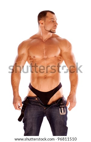 Muscular male bodybuilder on white background