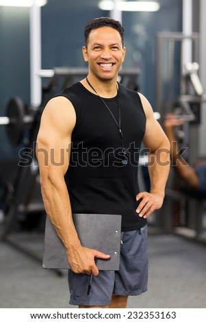 muscular male gym trainer portrait