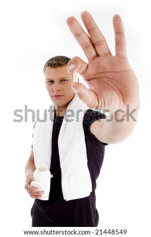 muscular male holding medicine on an isolated white background