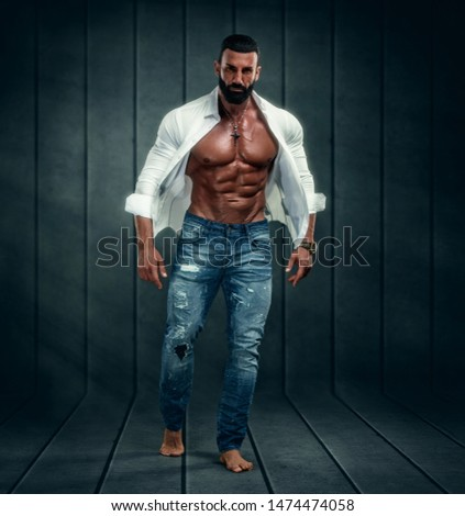 Muscular Male Model Wearing Unbuttoned White Shirt Exposing His Muscular Torso