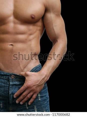 Muscular male torso isolated on black