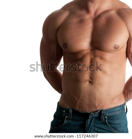 Muscular male torso of bodybuilder at jeans on white background