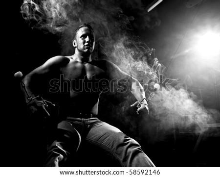 muscular man and abstract smoke - stock photo