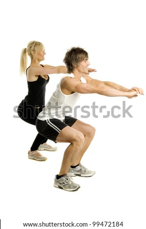 Muscular man and pretty blonde woman doing cardio exercises isolated on a white background