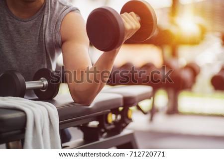 muscular man detail lifting weights