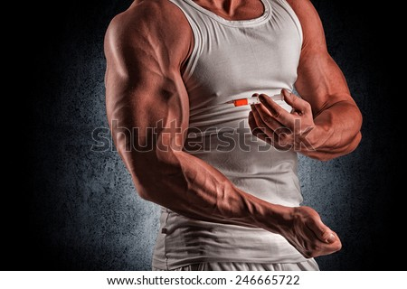 muscular man doing a shot in the biceps, steroids, pharmacology