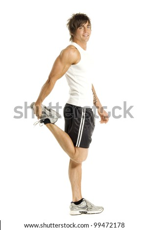 Muscular man doing stretching exercises isolated on a white background