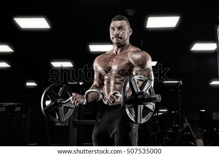 Muscular man during workout in the gym #507535000