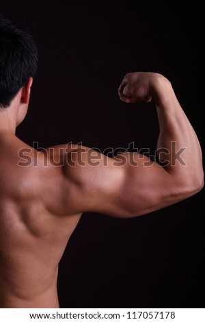 Muscular man flexing biceps to show how strong he is.