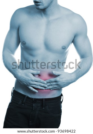 Muscular man holding painful stomach