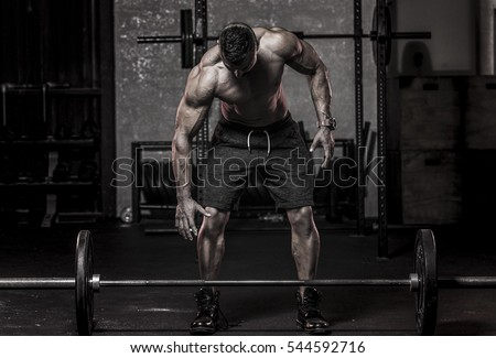 muscular man in about to pickup barbell  Stock photo ©