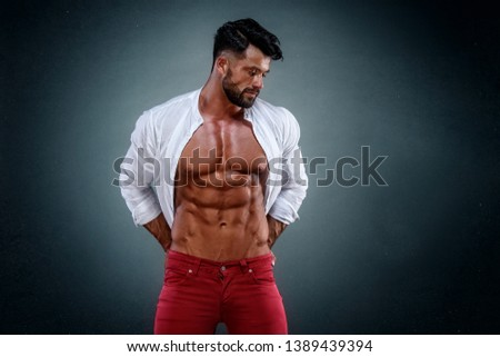 Muscular Man in Jeans Wearing Shirt Exposing his Muscular Build