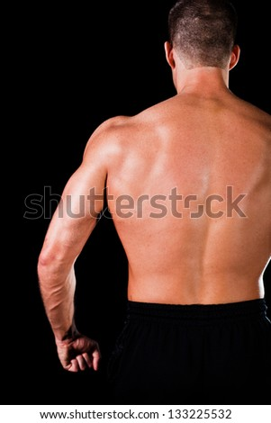 Muscular man isolated on black background