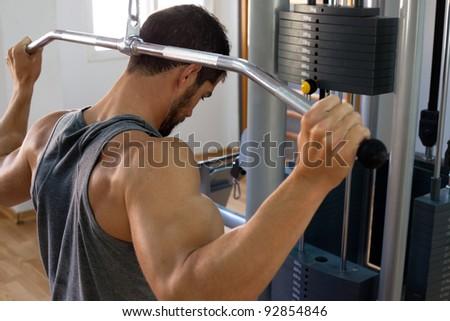 Muscular man lifting weights.