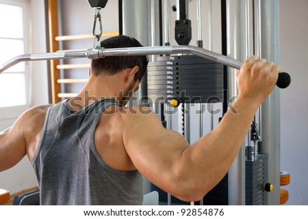 Muscular man lifting weights.