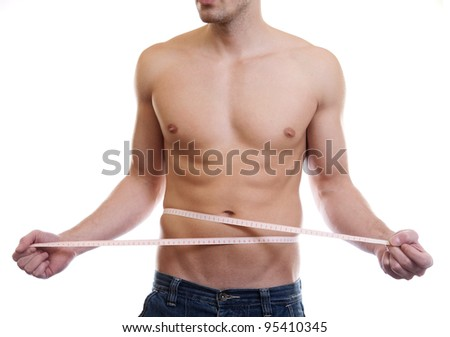 Muscular man measuring waist on white