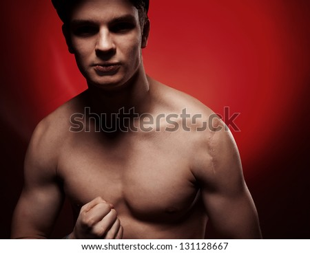 Muscular man portrait in the studio