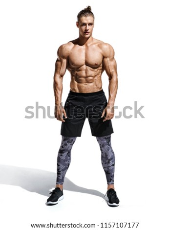 Muscular man shirtless. Photo of handsome man with perfect body after training isolated on white background. Strength and motivation. Full length #1157107177