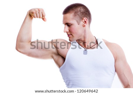 muscular man showing biceps - isolated