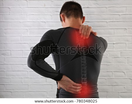 Muscular Man suffering from back pain. Sport exercising injury, Muscle spasm, rheumatism. Pain relief , chiropractic concept. #780348025