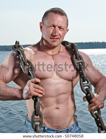 Muscular man with big chain