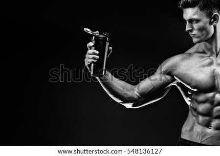Shutterstock Muscular man with protein drink in shaker over dark background