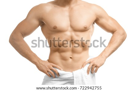 Muscular man wrapped in towel, on white background