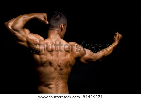 Muscular mans back - stock photo