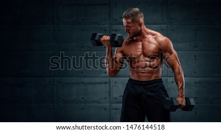 Muscular Men Exercise With Dumbbells , Performing Dumbbell Bicep Curls