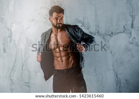 Muscular Men in Jeans Wearing Jacket But Exposing his Muscular Torso