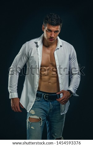 Muscular Men in Jeans Wearing Shirt Exposing his Muscular Build