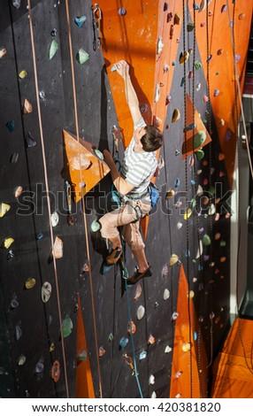muscular rock climber...