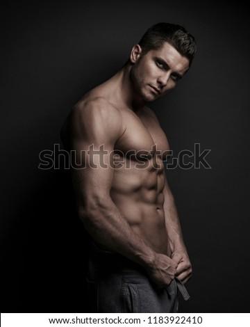 Muscular sexy man at dark background