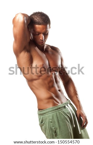 muscular super-high level handsome man posing on white background