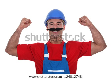 Muscular tradesman wearing a fake moustache