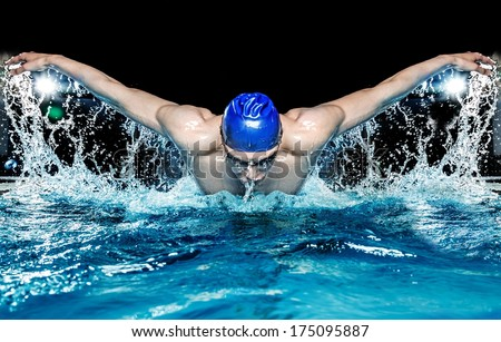 Muscular young man in blue cap in swimming pool #175095887