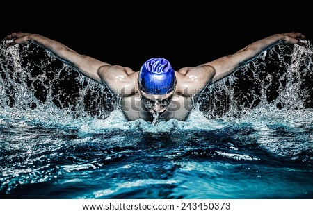 Muscular young man in blue cap in swimming pool #243450373