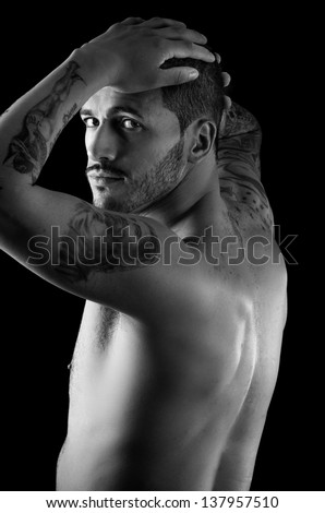 Muscular young man with many tattoos