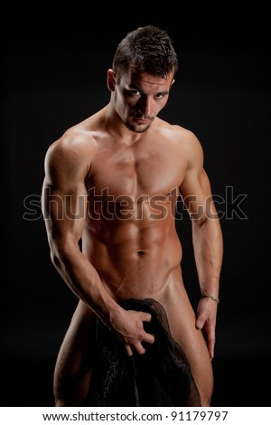 Muscular young sexy nude man wrapped in a silk cloth
