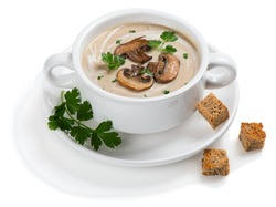 Mushroom cream soup decorated with sliced champignons, parsley and croutons in a white ceramic bowl. Isolated on white background