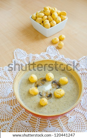 Mushroom cream soup with choux pastry garnish