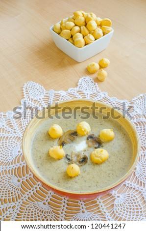 Mushroom cream soup with choux pastry garnish