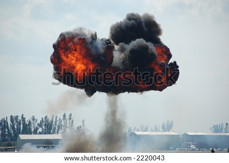 Mushroom Explosion Outdoors With Fire And Black Smoke