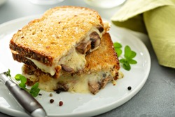 Mushroom grilled cheese sandwich on multigrain bread with thyme